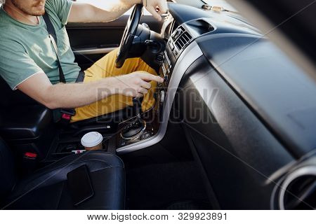 Guy Listening To Music In Car Stock Photo