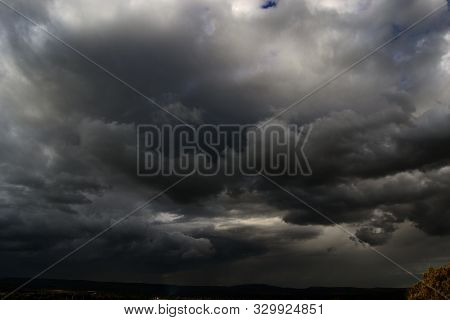 Dangerous Dark Storm Clouds Covering The Sky_dangerous Dark Storm Clouds Covering The Blue Sky