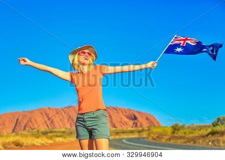 Uluru, Northern Territory, Australia - Aug 25, 2019: Happy Lifestyle Woman With Australian Flag In A