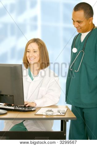Medical Team Working On Computer