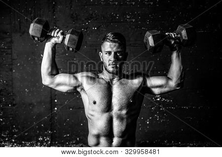 Shoulders Workout, Young Fit Strong Sweaty Man Shoulders Workout Training With Two Dumbbells In The