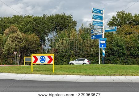 Roundabout With Road Signs Near Dutch City Terneuzen