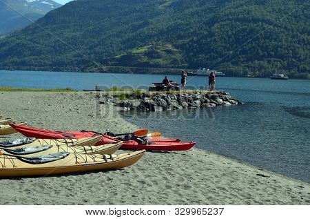 Kayaks on fjord shore in norwegian tourist destination Flam village. Travel, holidays and active lifestyle.Sognefjord.June 17,2018. Flam Norway Scandinavia.
