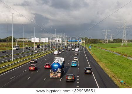 Muiden, The Netherlands - October 03, 2019: Rush Hour At Dutch Motorway A1 Near Amsterdam With Fourt