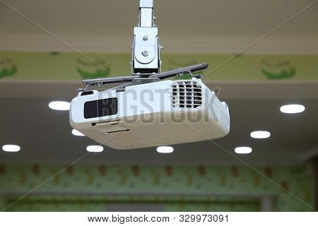 Projector At Business Conference Or Lecture.for Offices And Training Facilities. Irradiation. High Q