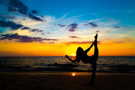Silhouette Yoga Sign Of Healthy Women On Beach Sunset