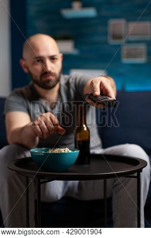 Scared Shocked Man Looking At Horror Thriller Movie At Tv, Eating Popcorn Trembled With Fright Sitti
