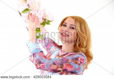 Happy Beautiful Woman With Long Blond Curly Hair Posing With Flowers In Studio On White Background