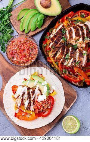 Chicken Fajitas With Bell Pepper, Onion, Salsa Asada, Avocado And Sour Cream Served On Soft Tortilla