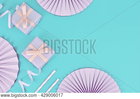 Party Flat Lay With Pink Gift Boxes, Paper Streamers, Drinking Straws And Paper Rosettes