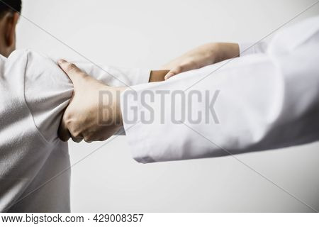 A Professional Physiotherapist Is Doing Stretching For A Patient, The Patient Has Muscle Dysfunction