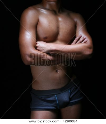 front view of the body of a hunky young asian in blue trunks poster