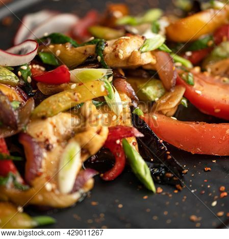 Stir-fried Oriental Dish, Vegetables With Scallion Or Shallot And Sesame Seeds. Close-up Shot. Soft