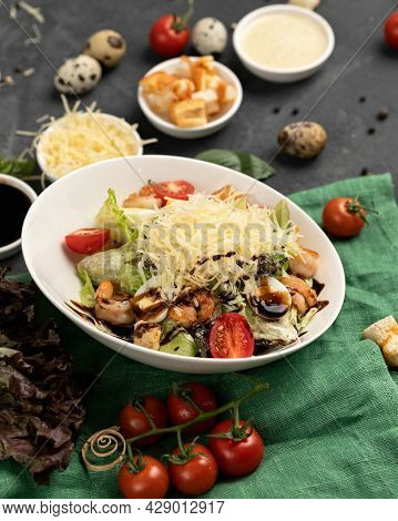 Shrimp With Salad And Grated Cheese. Caesar Salad With Seafood And Quail Eggs. White Bowl On Green S