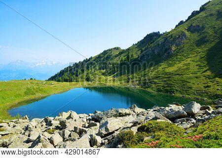 Mountain lake Lago di Chamole, Aosta valley, Italy. Summer landscape in the Alps.