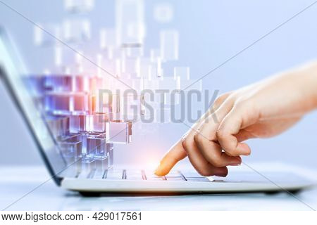 Hands of a young woman on keyboard