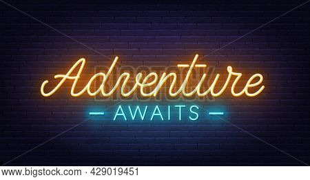 Adventure Awaits Neon Lettering On Brick Wall Background.