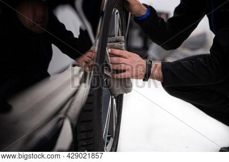Man Car Detailing Studio Worker Cleaning Car Wheel