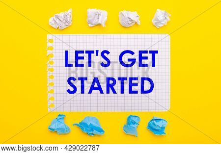 On A Yellow Background, White And Blue Crumpled Pieces Of Paper And A Notebook With The Text Let Is