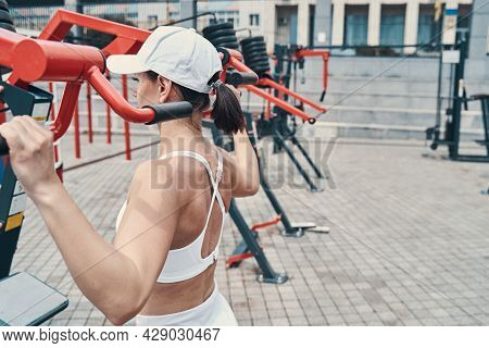 Athlete Having A Workout Outside On Cable Pull-down