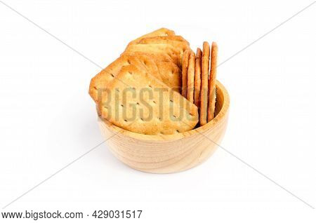 Group Of Square Cracker Or Biscuit Pile In Wooden Bowl On White Background