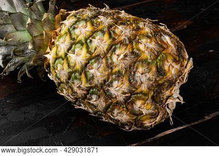 Yellow Pineapple Or Ananas Set, On Old Dark  Wooden Table Background