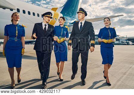 Aviators And Beautiful Flight Attendants Going Ahead