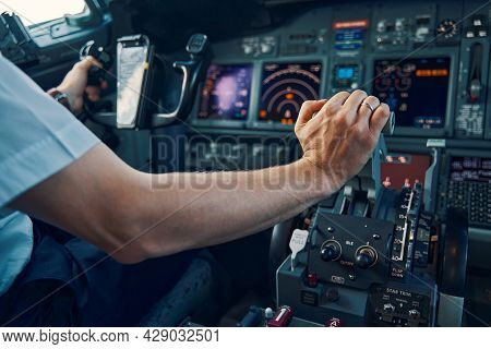 Aviator Seated In The Flight Deck Piloting An Aircraft