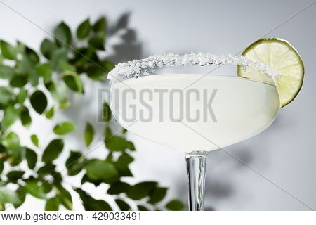 Fresh Summer Blended Muddy White Drink Margarita With Sugar Rim, Lime And Rum Shining In Sunlight Wi