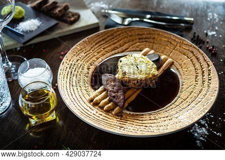 Black Angus 24 carat gold steak. Beef tenderloin, foie gras, fresh black truffle, white asparagus, port wine sauce. Delicious food closeup served for lunch in modern gourmet cuisine restaurant