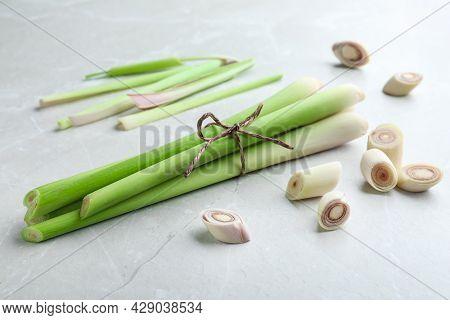 Whole And Cut Fresh Lemongrass On Light Table