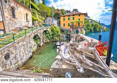 Town Of Nesso Waterfront And Idyllic Harbor  On Como Lake, Lombardy Region Of Italy