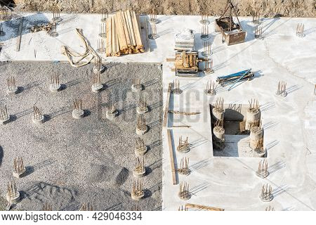 Concreting Work: Construction Site Worker During Concrete Pouring Into Formwork At Building Area Wit