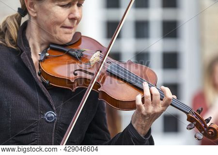 Guerlesquin, France - August 02 2021: Street Musician Playing Violin During The Monday's Market.