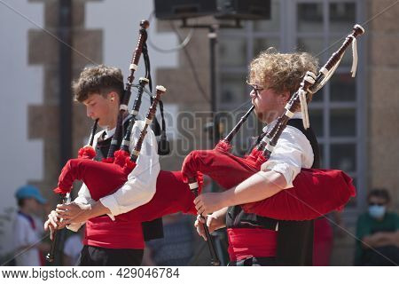 Morlaix, France - July 18 2021: Two Breton Musicians In Traditional Costume Playing Bagpipes.