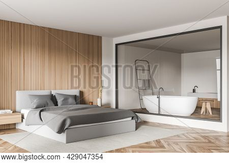 Corner Of The Bedroom Interior With Grey Bed, Wall Panelling, Rug, Shelves, Parquet, Light Beige Wal
