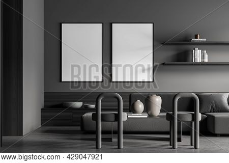 Two Framed Banners In The Living Room Interior In Grey. Sofa, Two Stools, Concrete Floor, Modern Min