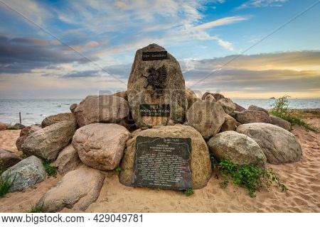 Hel, Poland - July 29, 2021: Memorial stones at the beach in Hel with the map of Poland at Baltic Sea, Poland.