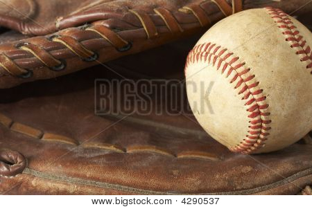 a macro of a baseball in glove poster