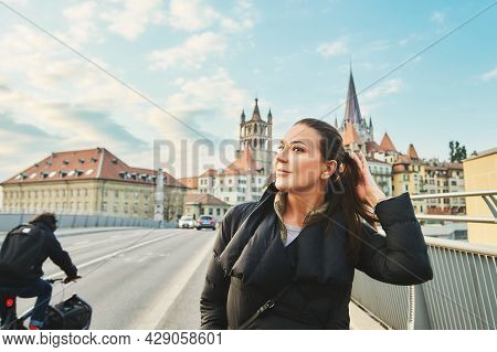 Outdoor Portrait Of Beautiful Young Woman Walking Down The Street, Image Taken At Pont Bessières, La