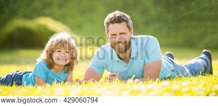 Parenting And Fatherhood. Fathers Day. Smiling Father And Son Having Fun In Park. Family Value