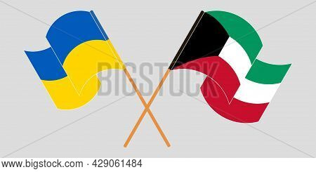 Crossed And Waving Flags Of The Ukraine And Kuwait