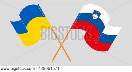 Crossed And Waving Flags Of Ukraine And Slovenia
