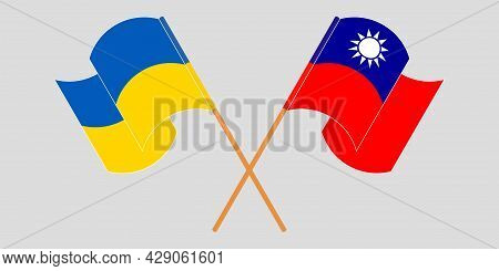 Crossed And Waving Flags Of Ukraine And Taiwan