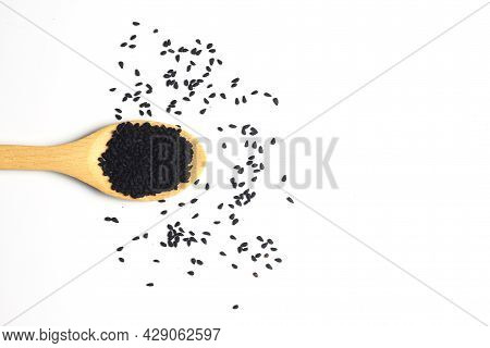 Nigella Sativa Or Black Cumin In Wooden Spoon Isolated On White Background