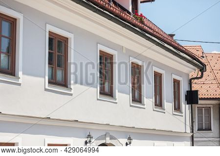 Typical Medieval Facade Of An Old Appartment Residential Building In A Street Of Old Town, The Histo