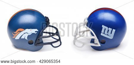 IRVINE, CALIFORNIA - 24 JUNE 2021: Football helmets of the Denver Broncos and New YorK Giants, Week One opponents in the NFL 2021 Season