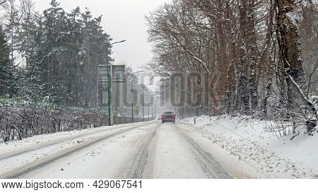 Driving in a snowstorm in the countryside from the Netherlands