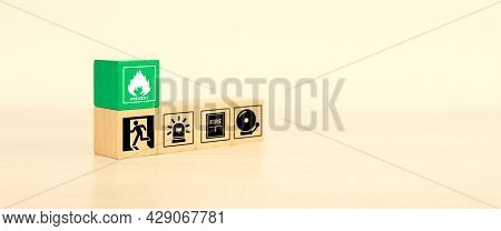 Fire Prevention, Close-up Cube Wooden Toy Block Stack With Prevent Icon With Door Exit Sing Or Fire