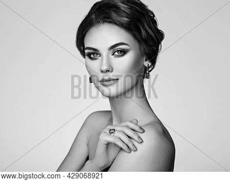 Portrait Beautiful Woman With Jewelry. Model Girl With Manicure On Nails. Beauty And Accessories. Bl